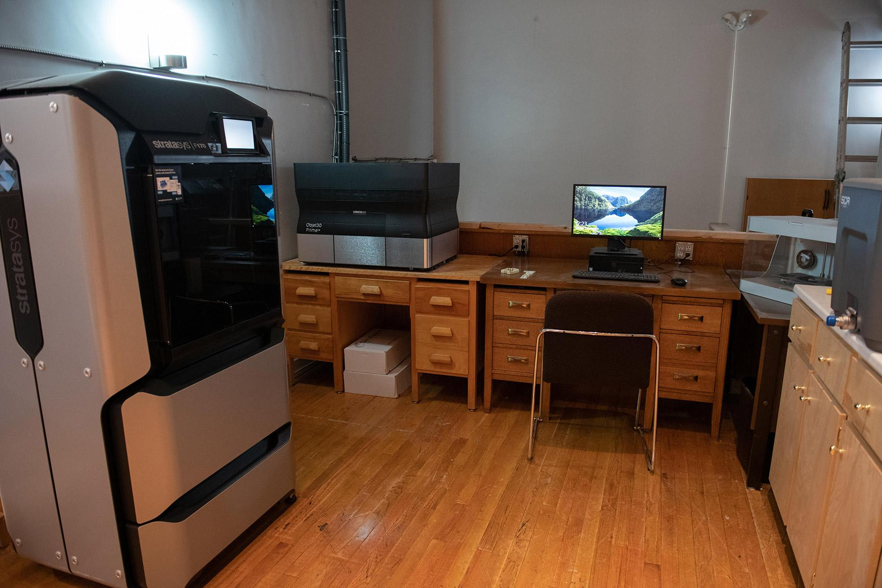 An office space that works as a 3D printing lab.