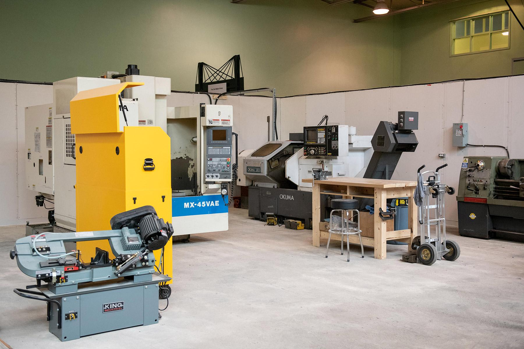 Metal Working Shop includes horizontal bandsaw, Dewalt toolbox, Okuma CNC mill and lathe