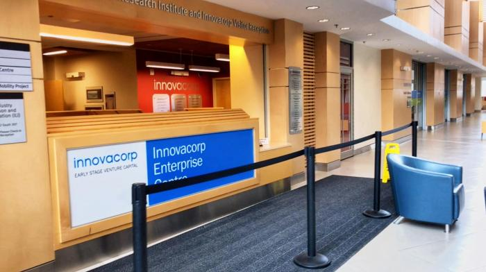 A front desk in a corporate building with a sign that reads, 'Innovacorp Enterprise Centre'.